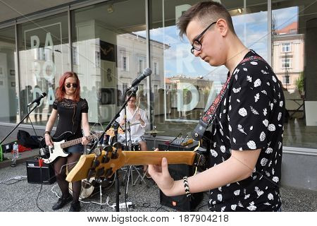 VILNIUS LITHUANIA - MAY 20: Unidentified musicians play guitar in Street Music Day on May 20 2017 in Vilnius. Its a most popular event on May in Vilnius Lithuania