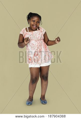 Little african girl having fun and dancing