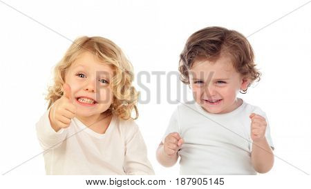 Two happy small children saying Ok and laughing isolated on a white background