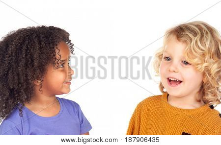 Two adorable children looking at each other isolated on a white background
