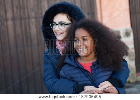 Two happy girls friends lauging outside