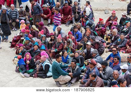 LAMAYURU INDIA - JUNE 13 2015: Unidentified buddhist old people during mystical mask dancing Tsam mystery dance in time of Yuru Kabgyat Buddhist festival at Lamayuru Gompa Ladakh North India