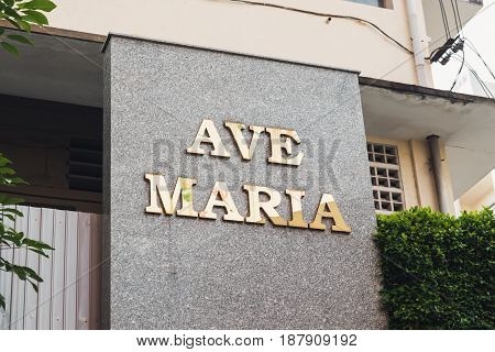 Sign with text Ave Maria. Gold letters on a marble wall. Tan Dinh Church or Sweet church in Ho chi minh Vietnam