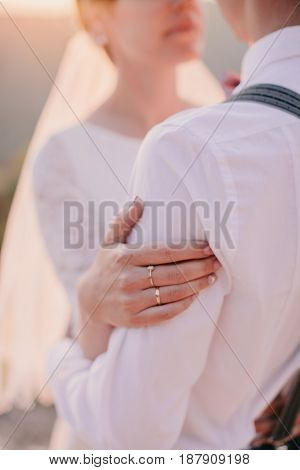 Bride And Groom Holding Hands Together