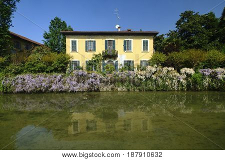 Milan (Lombardy Italy): road for pedestrians and bicycle along the canal of Martesana. Facade of historic house