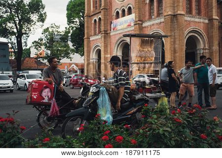 Notre-Dame Cathedral Basilica of Saigon. Dealers in food near Cathedral Basilica of Our Lady of The Immaculate Conception. Ho Chi Minh city Vietnam 12 may 2017