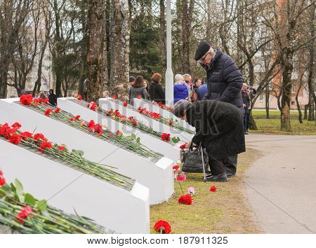 Kirishi, Russia - 9 May, Older people have memorable plates, 9 May, 2017. Laying wreaths and flowers in memory of the fallen at the Eternal Flame.