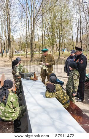 Kirishi, Russia - 9 May, Adults and small fighters in the park, 9 May, 2017. Festive events in the city park on the occasion of Victory Day.