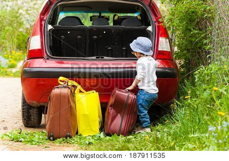kid loading suitcase baggage pack car travel