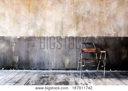 wooden chair in grungy interior. Loneliness estrangement alienation concept. poster