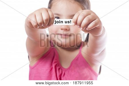 Young girl holding a fortune cookie paper with the message Join us