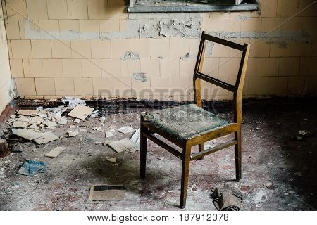 chair inside an old abandoned house in ruins