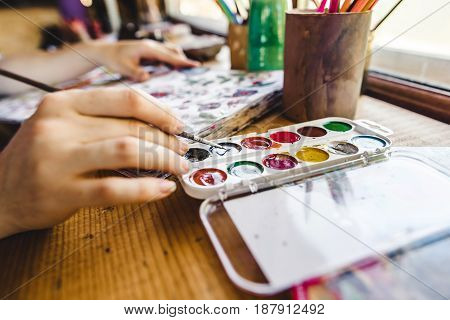 Girls Hands With Brush Painting