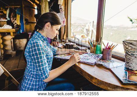 Beautiful Young Painter In Her Studio