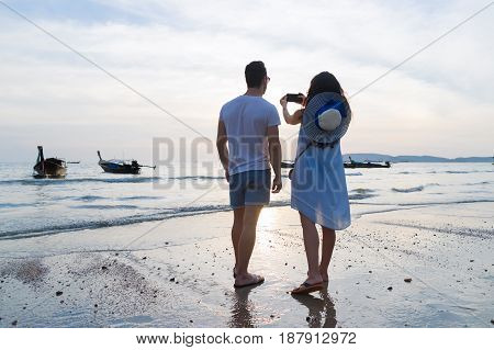 Couple Beach Summer Vacation, Man Woman Take Photo Sunset Young Guy Girl Back Rear View Sea Ocean Holiday Travel