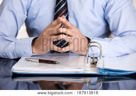 Businessman is talking about the contract high quality and high resolution studio shoot