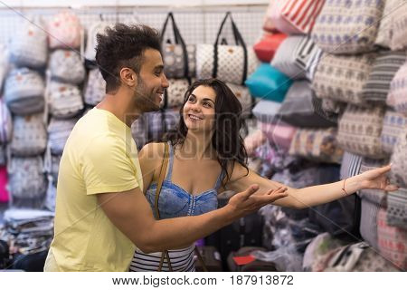 Young Couple On Shopping Choosing Bag, Man And Woman Happy Smiling In Retail Store Selecting Female Purse