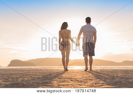 Couple Beach Summer Vacation, Man Woman Yjlding Hands Sunset Beautiful Young Guy Girl Back Rear View Sea Ocean Holiday Travel