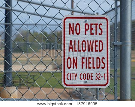 A new sign goes up on city ball park fences to better oversee the facilities.