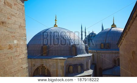 Blue mosque with Domes of the Hagia Sophia in the foreground, Istanbul, Turkey.
