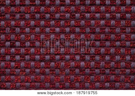 Dark red background from checkered pattern textile closeup. Structure of the wine wicker fabric macro.