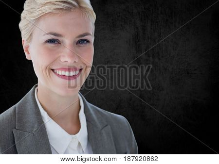 Digital composite of Business woman smiling against black wall