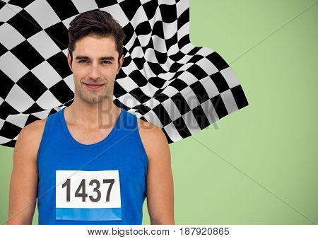 Digital composite of Male runner with number on shirt against green background and checkered flag