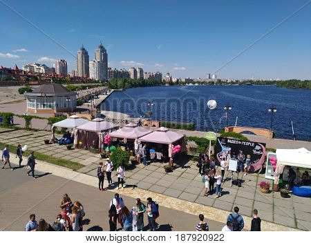 KIEV - UKRAINE - MAY 2017: Videopeople Festival-2017 in Kiev. People stroll along the embankment of the Dnieper River, Bloggers visited this top event for youtubers