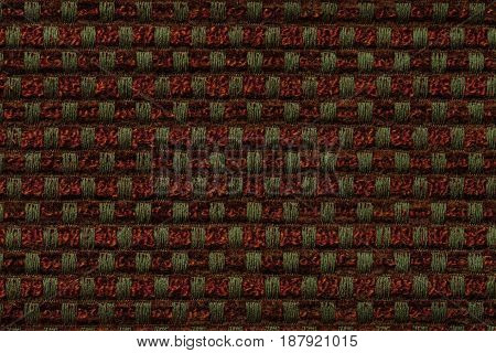 Dark red and green background from checkered pattern textile closeup. Structure of the ginger wicker fabric macro.