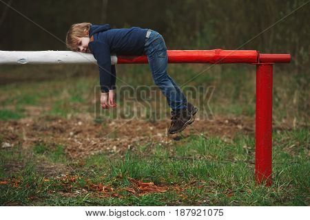 photo of little playful boy with barrier