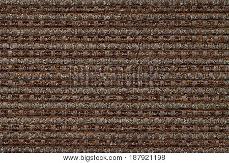 Dark brown background from checkered pattern textile closeup. Structure of the bronze wicker fabric macro.