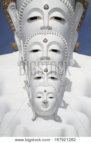 Five white buddha statues sitting well alignment in front of blue sky and decorating wonderful attractive mirror, one of the most interesting landmark in north of Thailand