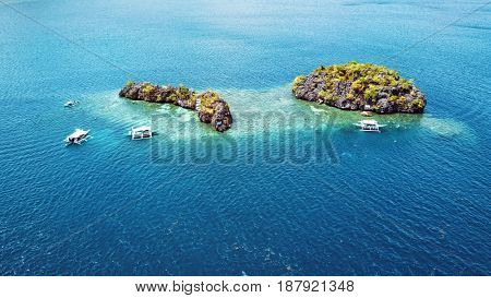 Aerial view of small islands with boats in Coron Bay. Palawan May 2017