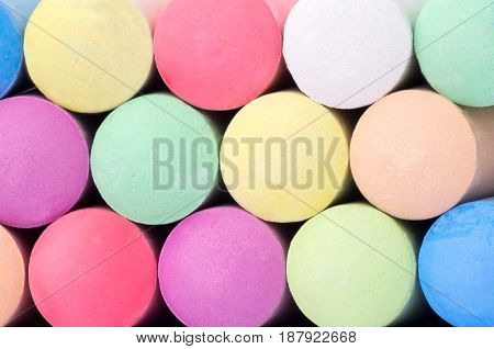 Close-up of rows of colorful blackboard chalk background