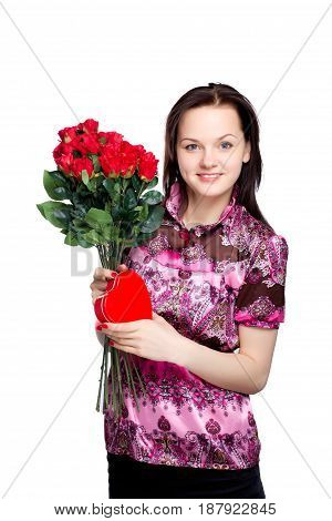 beautiful young woman with a bouquet of red roses and heart-shape gift on white