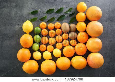 Beautiful composition of citrus fruits and kiwi on grunge background