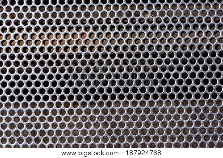 Texture of metal with round through holes, holes in metal
