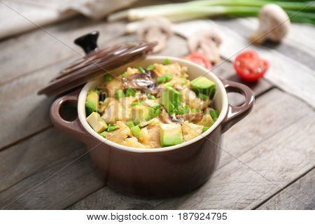 Delicious chicken casserole meal in saucepan on table