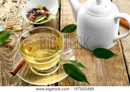 Teapot and cup of tea on wooden table