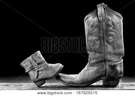 Baby Cowboy boot/Cowgirl and Daddy cowboy boot with room for your type in black and white. poster
