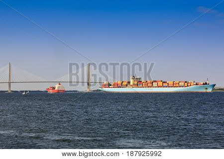 Charleston, SC, USA - 09/09/2016: Freighter ships entering and leaving the Cooper River at Charleston SC