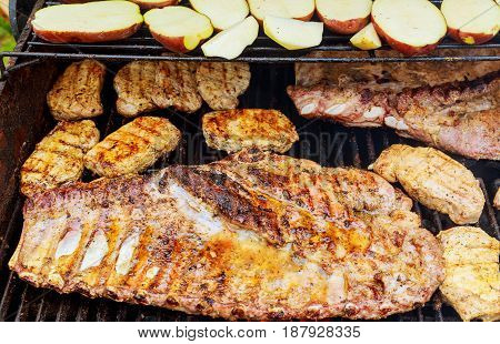 Pork Rib Steak On The Hot Barbecue Grill With Bright Flames