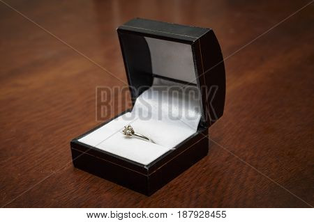 diamond engagement ring in a ring box