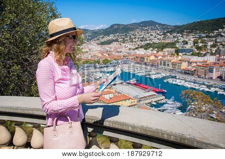 Tourist in Nice French Riviera looking in map