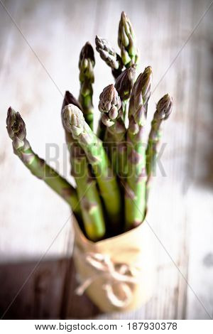 bunches of fresh asparagus closeup on wooden table
