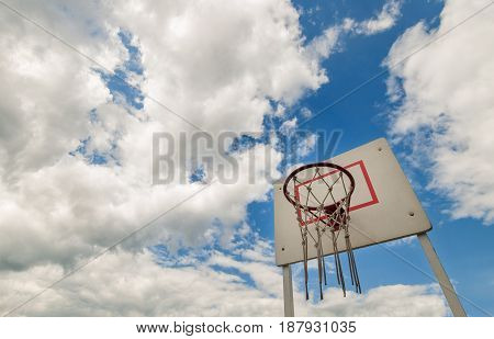 basketball court, under the open sky in the city