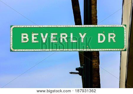 Beverly Hills, CA, USA - 07/01/2015: Beverly Drive green street sign in Beverly Hills California