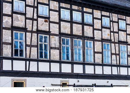 Very Many windows in an old half-timbered house