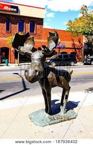 Coeur d'Arlene, ID, USA - 07/19/2015: Mudgy Moose statue the mascot of Coeur d'Alene in Idaho