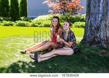 Coeur d'Arlene, ID, USA - 07/19/2015: Two college girls enjoying the summer sunshine and ice creams in Coeur d'Alene Idaho